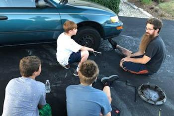 Changing a tire - EMPOWERING THE NEXT GENERATION